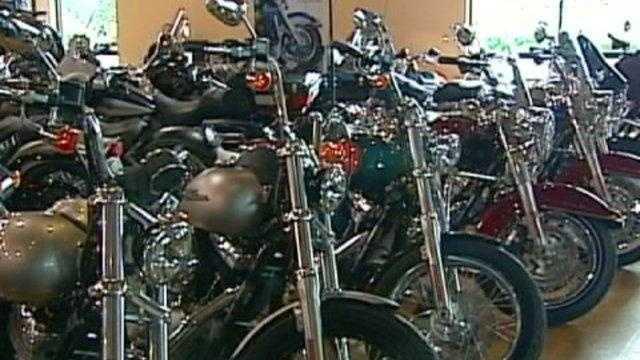 Harley Davidson motorcycles, in dealer shop - 19649814