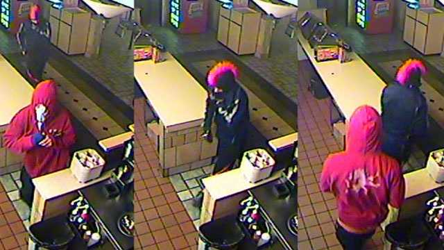Police release surveillance images of two men sought in connection with a burglary at a Kansas City area McDonald's restaurant
