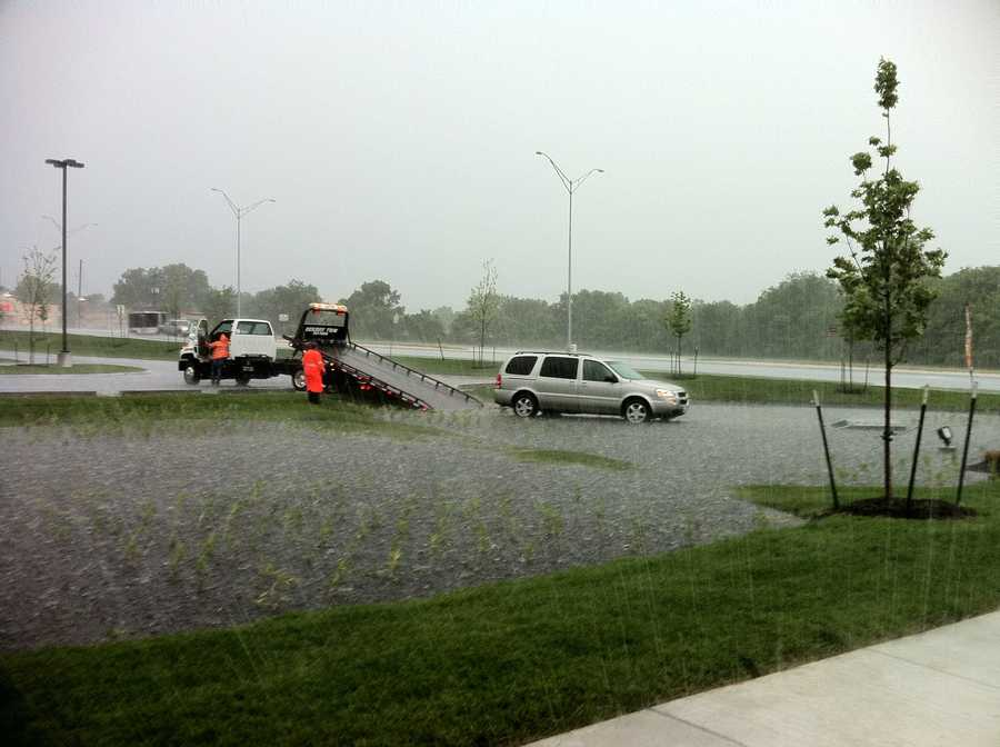A vehicle gets stuck after it ends up in some high water in Belton, Mo.