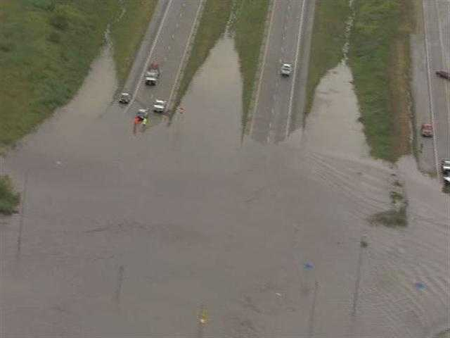291 Highway between 50 Highway and 150 Highway flooded on Friday morning.