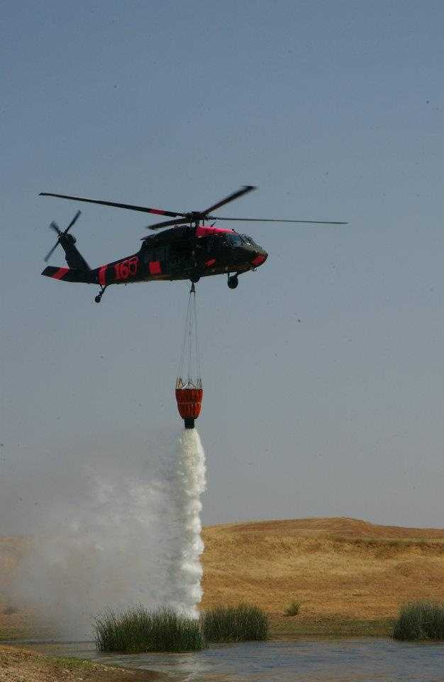 The National Guard said the A UH-60 Black Hawk helicopter being sent is equipped with a 660-gallon bucket that can scoop water and dump it on flames.