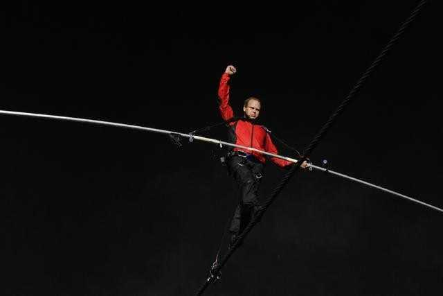 Wallenda carried a 40 pound pole to help his balance