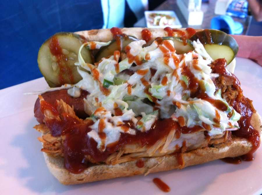 All-star BBQ dog (all beef hot dog tipped w/pulled pork - cole slaw - pickle slices & BBQ sauce)