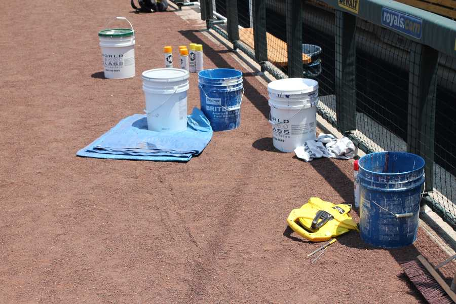 Buckets of paint used on the field.