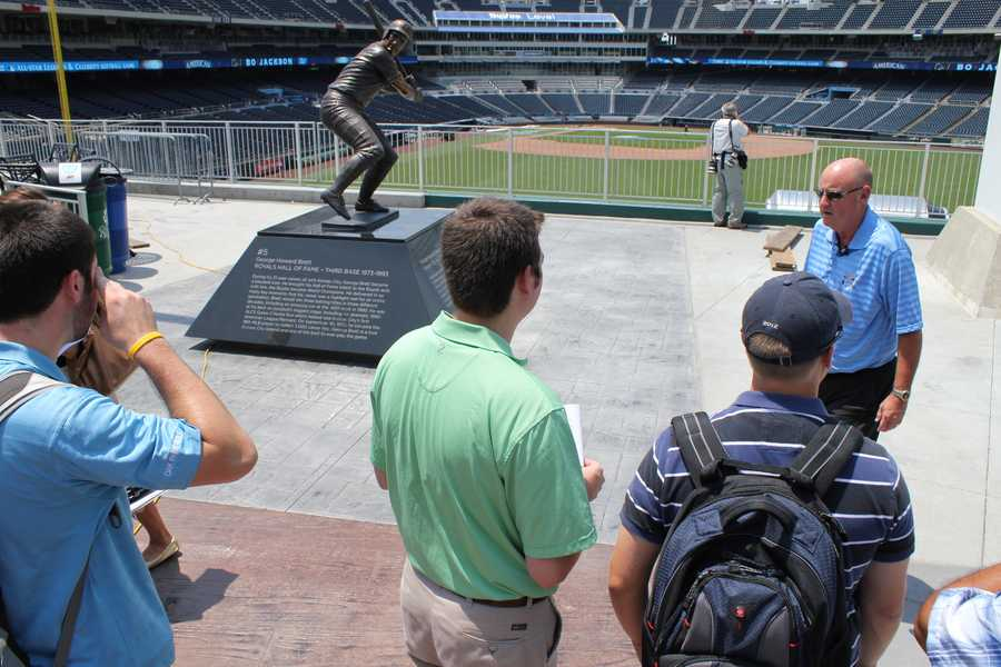 A Kansas City Royals representative shows members of the media where some of the broadcast desks will be setup.