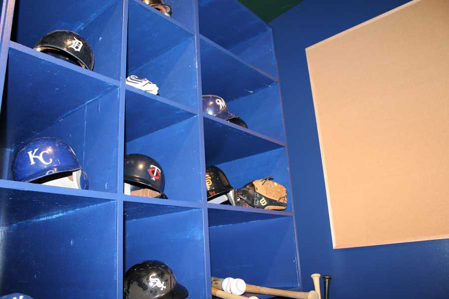The replica All-Star Dugout includes All-Star helmets.
