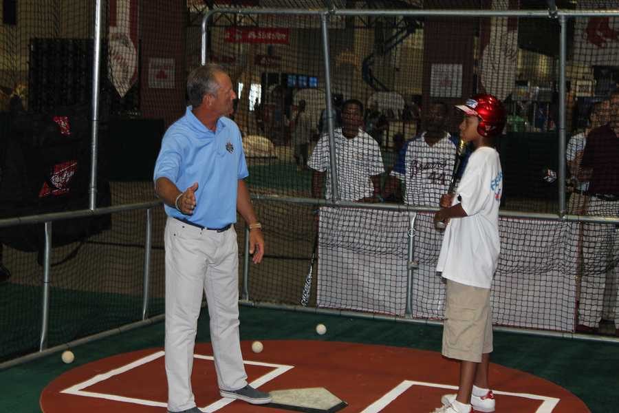 George Brett gives batting advice to a younger player at the Home Run Derby exhibit.
