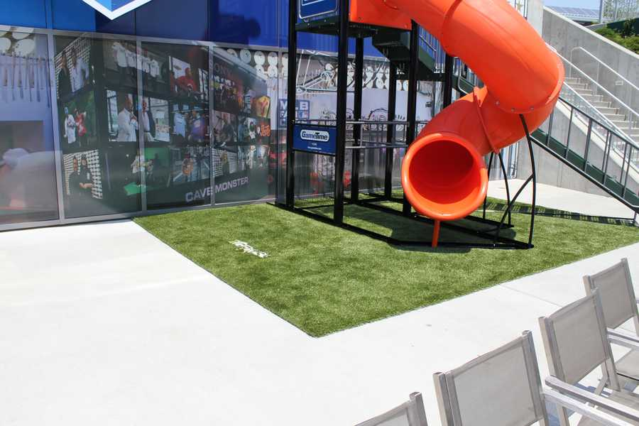 Slide and grass installed for the MLB Fan Cave.