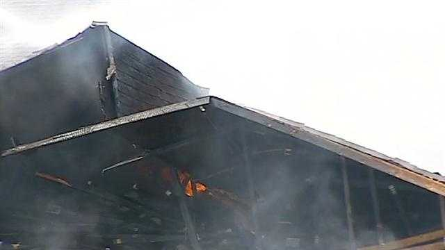 A portion of the motel's roof collapses.