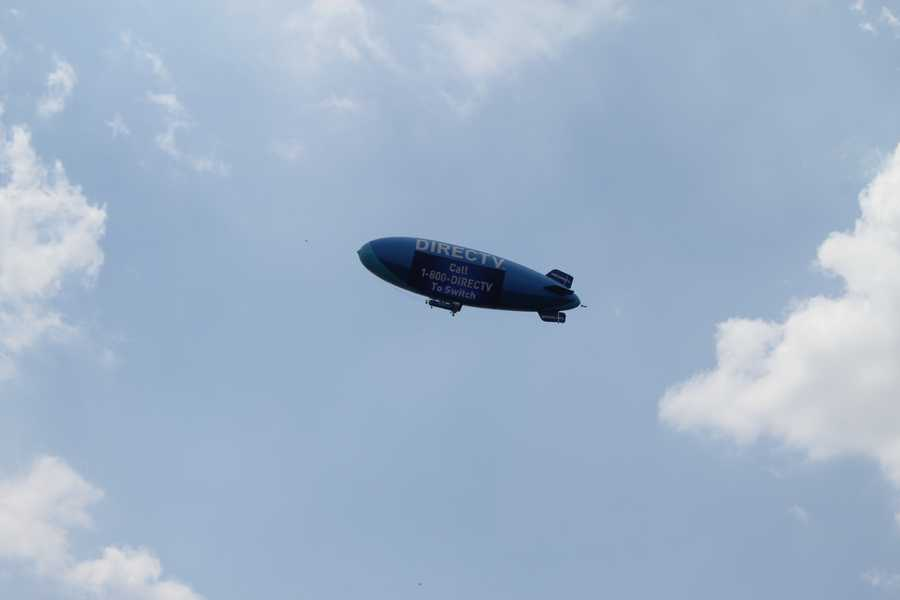 The DirecTV blimp flies over the Country Club Plaza.