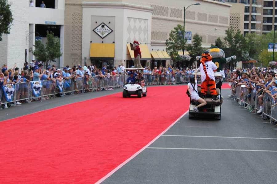 Mascots on golf carts warm up the crowd.