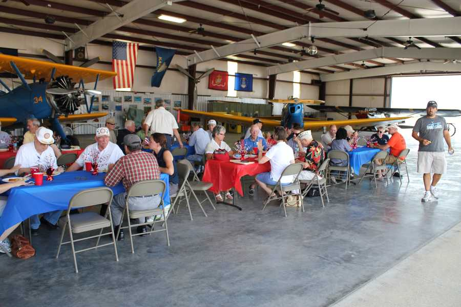 """Former WWII aviator veterans, bomber builders and their families were at the New Century Air Center on Thursday to greet """"Show Me!"""" """"Show Me,"""" along with more than 20 other vintage aircraft, will be on display during the Heart of America Wing of the Commemorative Air Force Air Expo on July 14 and 15 at the airport."""