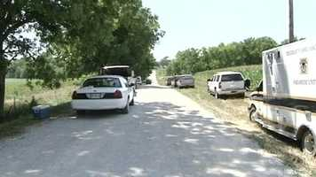 Several officers and investigators spend the weekend searching fields for the sisters.