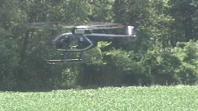 A helicopter is brought in to help search for the missing sisters.