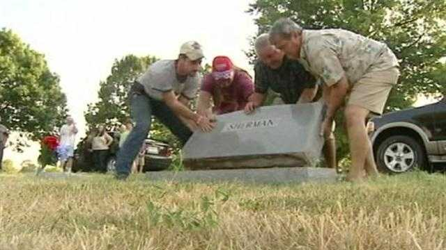 Volunteers worked to replace headstones that vandals overturned overnight at the Belton Cemetery. KMBC 9's Martin Augustine reports.