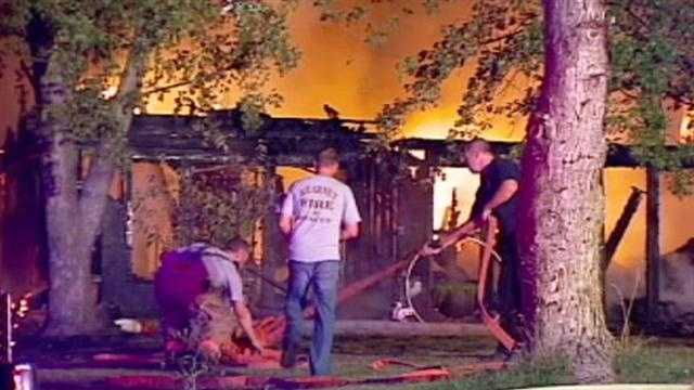 A family of 4 and their 2 cats safely escaped from their home near Smithville, which caught fire overnight.