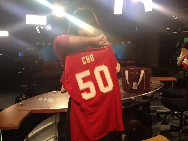 Diane Cho shows off her new Chiefs gear.