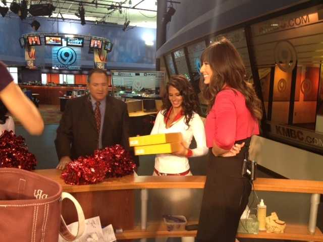 The Chiefs Cheerleaders had yellow boxes with something inside.