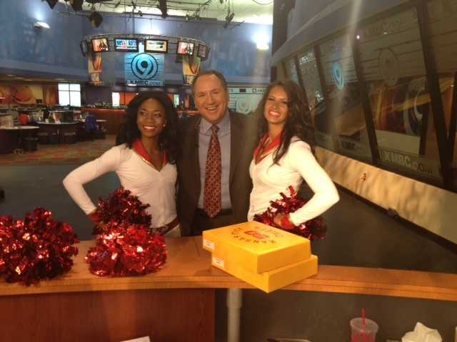 KMBC's Kris Ketz is happy to pose with the Chiefs Cheerleaders.