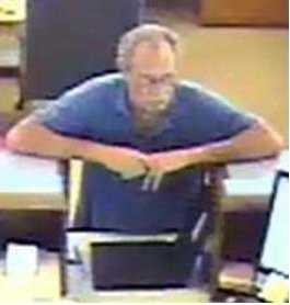 FBI: He is normally seen wearing jeans and a blue polo shirt or blue t-shirt. The suspect also has a mustache and wears glasses.