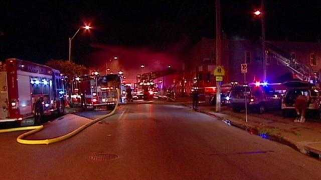 Four people -- two firefighters and two residents -- were injured in a late-night apartment fire in northeast Kansas City.
