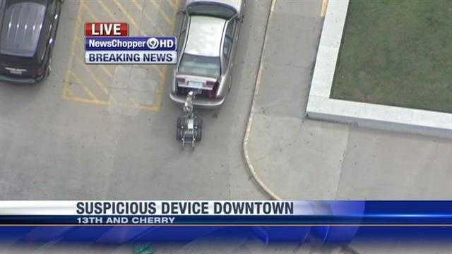 KMBC's Micheal Mahoney reported that bomb squad members were called to the area about 12:15 p.m., and focused their attention on the car parked in a handicapped spot.