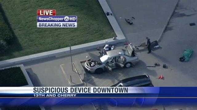 Police get a closer look at the vehicle involved in Friday afternoon's bomb threat.