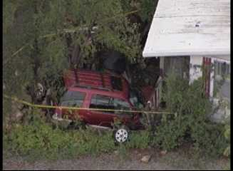 An SUV crashed into a house at 167th Street and Metcalf Avenue Wednesday morning. The wreck is under investigation.