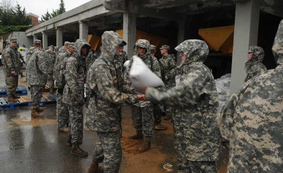 Soldiers from the 3d U.S. Infantry Regiment (The Old Guard), move sand bags onto pallets at Joint Base Myer-Henderson Hall, Va., Oct. 29, 2012. The Regiment will do all it can to help out the people of the area as Hurricane Sandy bears down the Eastern Seaboard.