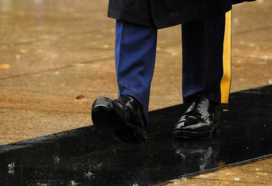 Via the Army: Spc. Brett Hyde, Tomb Sentinel, 3d U.S. Infantry Regiment (The Old Guard), takes his twenty-one steps across a water soaked mat while guarding the Tomb during Hurricane Sandy at the Tomb of the Unknown Soldier, Arlington National Cemetery, Va., Oct. 29, 2012. The Tomb is guarded 24 hours a day, 7 days a week. Snow, rain, wind or heat has never stopped the Tomb Sentinels from guarding the tomb for over 64 years.