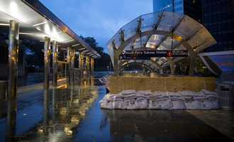 The number 1 subway train station is blocked by sandbags at Battery Park in New York Monday, Oct. 29, 2012, in preparation for a possible storm surge as Hurricane Sandy approaches the East Coast. Hurricane Sandy continued on its path Monday, forcing the shutdown of mass transit, schools and financial markets, sending coastal residents fleeing, and threatening a dangerous mix of high winds and soaking rain.