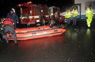 An FDNY inflatable is prepared for launch along 14th street east of Avenue B where water has trapped people in the wake of Hurricane Sandy, Monday, Oct. 29, 2012, in New York.