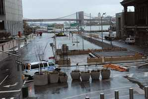 Water reaches street level at the West Street entrance to the Battery Park Underpass, Tuesday, Oct. 30, 2012, in New York.