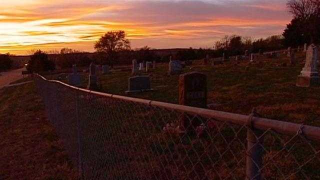 A longtime legend listing a small Kansas town as a gateway to hell has caused problems for people to live there and the families of those buried in a cemetery there.