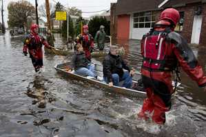 Rescuers bring people out by boat in Little Ferry, N.J., Tuesday, Oct. 30, 2012, in the wake of superstorm Sandy. Sandy arrived along the East Coast and morphed into a huge and problematic system, putting more than 7.5 million homes and businesses in the dark and causing a number of deaths.