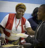 The Red Cross dispatched dozens of emergency response vehicles to neighborhoods all over New Jersey to feed residents who were impacted by Hurricane Sandy. Two of the feeding teams brought 1,000 meals each to a housing complex for the elderly and disabled that remains out of power in Bayonne, NJ.