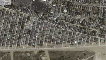 """Breezy Point section of Queens, New York. """"Before"""" image captured by Google&#x3B; """"After"""" image captured by NOAA's National Geodetic Survey."""