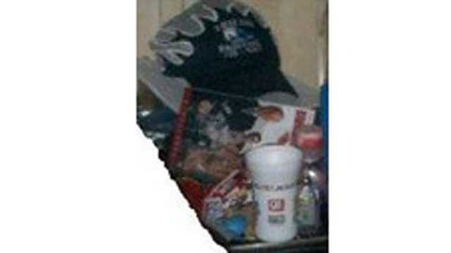 Enhanced background photographs show what appears to be a child's drinking cup from the QuikTrip chain and a baseball cap with a team logo.