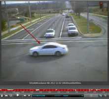 Lenexa police released a series of photographs taken by an intersection camera at 101st Street and Woodland Road.  A white car was captured in this intersection near the time of the attempted abduction of an 11-year-old boy.  Police said this is a vehicle of interest and they do not know whether it is connected to the case.