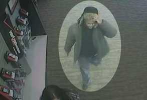 Kansas City, Mo.,  police release surveillance pictures from a robbery at a Verizon Wireless store at 4040 Mill St. on Jan. 12.