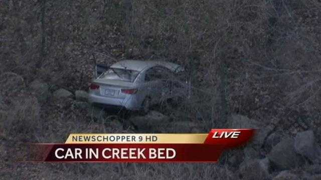 Car in Creek Bed