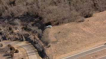 It appeared a search was happening in a wooded area near the end of the chase