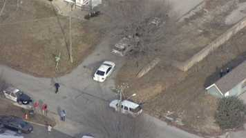 Images from a standoff at a home near Truman Road and Vermont Avenue.