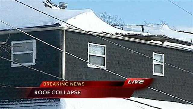 A roof at an apartment building in Kansas City, Kan., partially collapsed on Friday afternoon.  It was not immediately known if Thursday's historic snowfall contributed to the collapse.