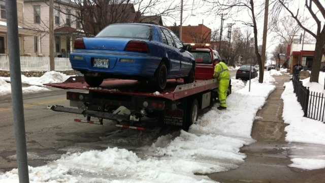 Car getting towed on Monday morning