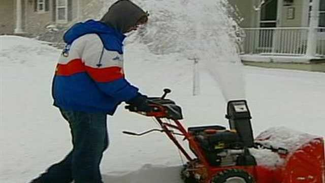 Resident with snow blower
