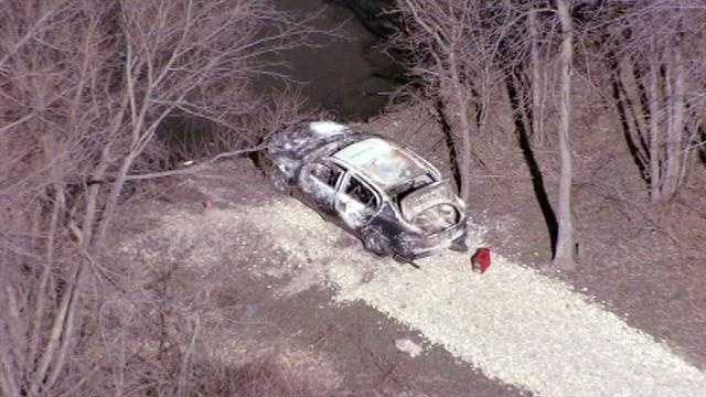 Burned body discovered in partially submerged vehicle 1