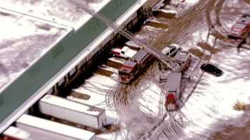 Images from a partial roof collapse at Aspen Products on Clary Boulevard in Kansas City, Mo. Employees said the roof collapsed around lunch time on Monday.