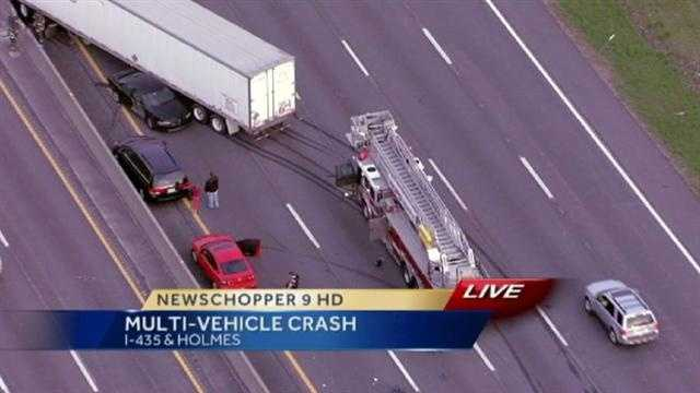An accident involving 10 vehicles, including a tractor trailer, snarled traffic on Interstate 435 West at Holmes Road on Monday morning. These are images from the scene.