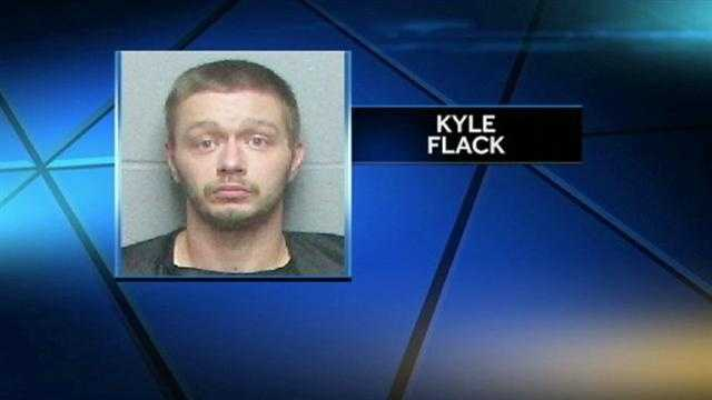 Kyle Flack, the man held in connection with the slayings of three adults and a baby in Franklin County, has served time in prison for shooting his former boss.